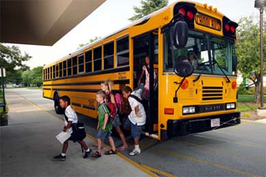 Students getting off of school bus going into school