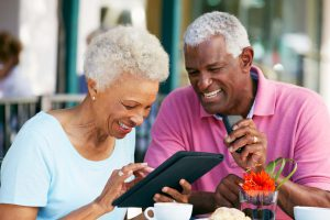 Two retirees looking at a moble device