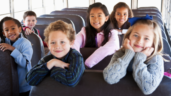 Six students sitting on a bus