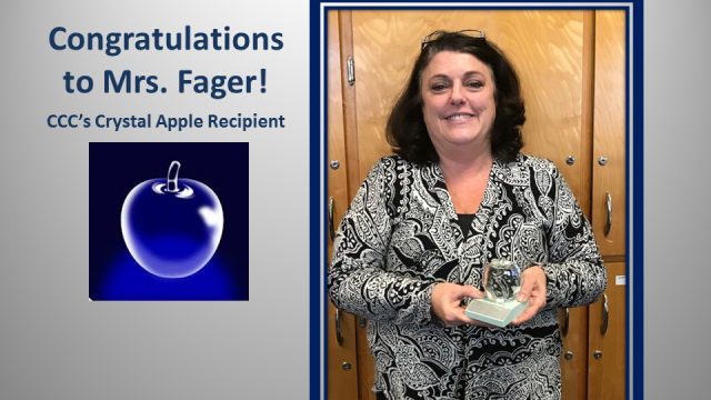 Grace Fager holding the Crystal Apple Award and a clear apple on a dark blue background