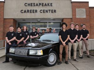 Automotive technology students stand with car in front of CCC