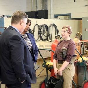 Dr. Cotton meets with a welding student at the Career Center.