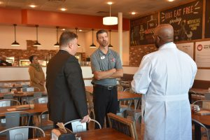 Dr. Cotton meeting touring Your Pie in Greenbrier for the grand opening.