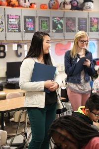 New teacher candidates visit classrooms.