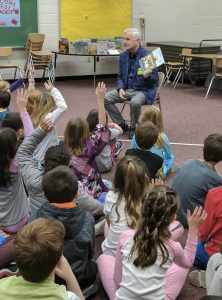 Mayor Rick West reads to students at Great Bridge Intermediate.