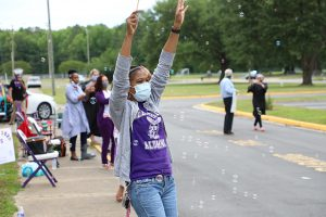 DCHS Teacher cheers for drive by graduate