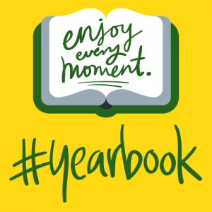 "gold backround, with green book open that reads ""enjoy every moment"" in green letters. #yearbook in green letters."
