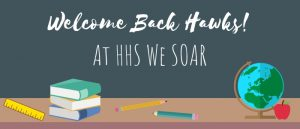 Welcome Back Hawks! at HHS we SOAR desk with ruler, books, pencils, globe, and an apple