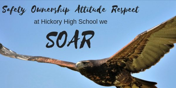 Safety Ownership Attitude Respect at Hickory High School we SOAR flying hawk in blue sky