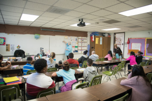 students and teacher in a classroom