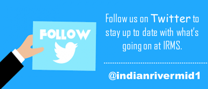 Follow, follow us on twitter to stay up to date with what's going on at IRMS @indianrivermid1 - hand holding sign with twitter symbol