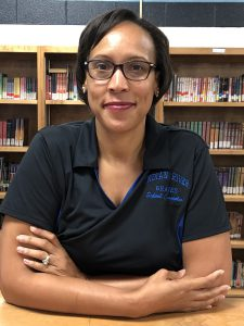 picture of aleke sharpe wearing blue Indian river braves school counselor shirt