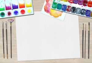 blank canvas and art supplies