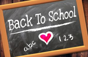 "Chalkboard with the phrase ""Back to School"". There is a red heart between ABC and 123."