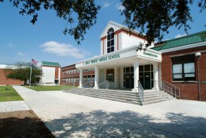 Front entrance of Great Bridge Middle School with blue sky showing in background