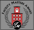Red School House with crest and Facilities Masters Award