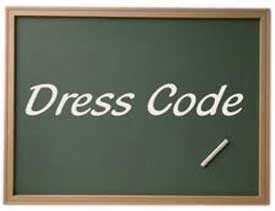 A chalk board with the word Dress Code written on it