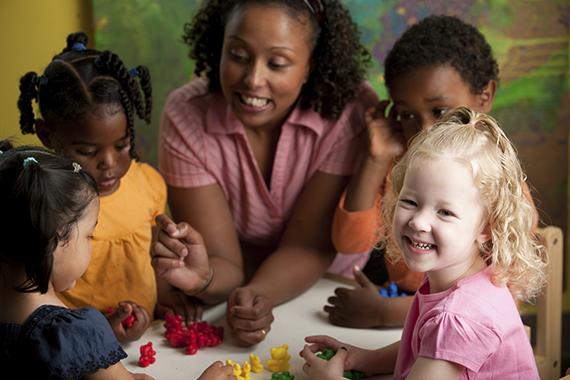 teacher with tchildren and art