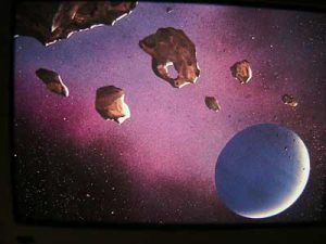Asteroids in pink galazxy