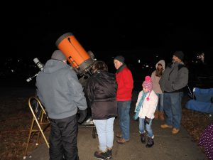 visitors to the planetarium viewing the lunar eclipse with the planetarium's telescope