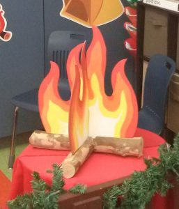a fake fire & logs made out of paper sitting on a table