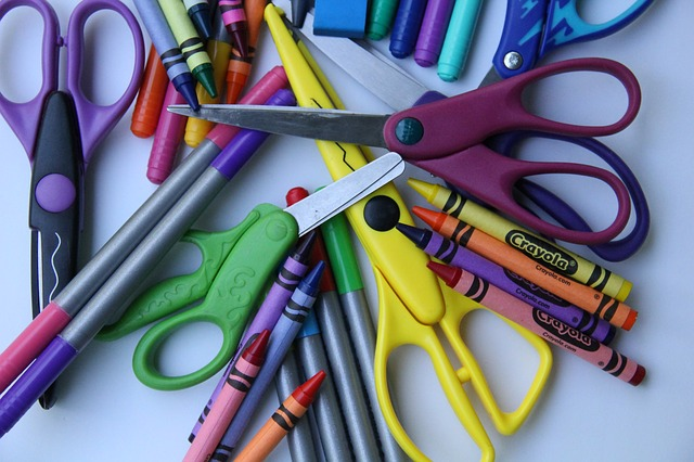 Collection of scissors, crayons, and mechanical pencils