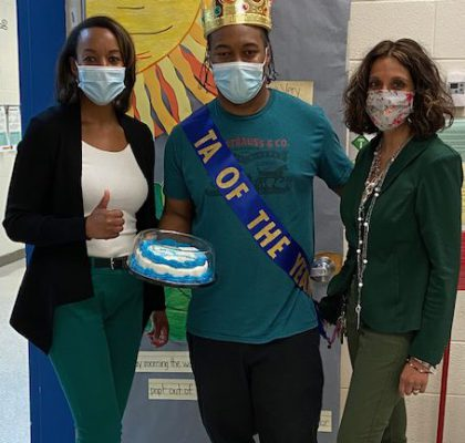 Mrs. Johnson (left), Exzavier Johnson (center), Mrs. Gould (right)