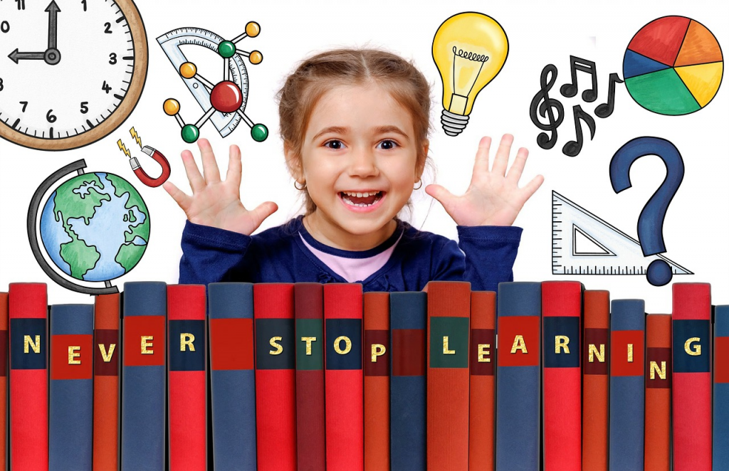 "Child behind a stack of books with her hands up, the spines of the books read ""never stop learning"""