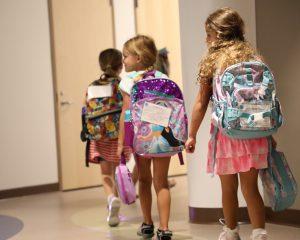 Kindergartners walking single file to their classroom.
