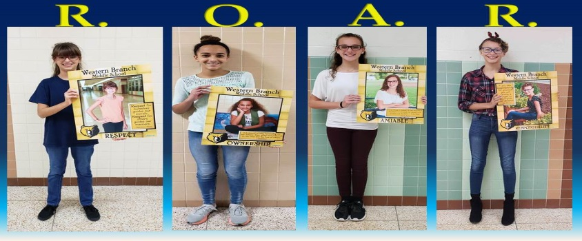 R. O. A. R. Pictures of students holding posters