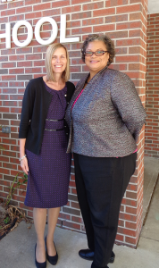 Principal and Assistant Principal in front of building