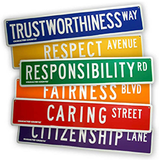 street signs: trustworthiness way, respect ave, responsibility rd, fairness blvd, caring street, citizenship lane