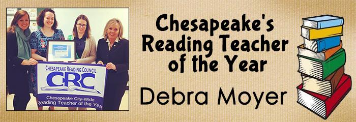 debra moyer holding banner for chesapeake city wide reading teacher of the year