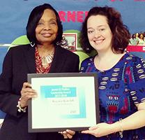 Principal Regina Ratcliff accepting James D. Mullins Leadership Award