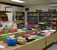 partial view of teacher supply store shelves and table