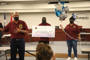 Members of the Mount church present a check to CPS