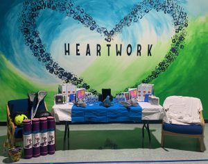 "Mural at CCSS that reads ""HEARTWORK"". Also, photo shows school supplies purchased for CCSS students and faculty thanks to a donation from Calvary Revival Church."